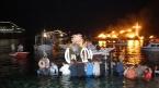 Op Goede Vrijdag komen op Tinos de Epitaphios-processies van zeven kerken samen aan de waterkant van Chora. Dan gaan ze naar de kerk van Aghios Nikolaos, waar de Epitaphios in het water wordt meegenomen om de zeelui te zegenen. Dan worden ook drie grote kruizen in brand gestoken en brengen vissersboten met fakkels een eerbetoon aan de processie.