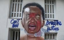 De muurschildering naar aanleiding van de dood van Goerge Floyd